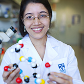 Scientist with molecule model